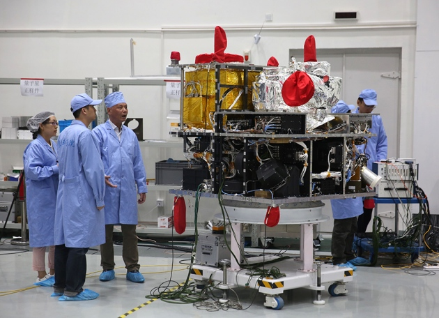 China's 600-kilogram quantum satellite contains a crystal that produces entangled photons.